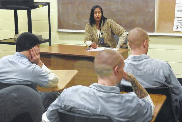 Catalina Thompson addresses inmates during a intensive outpatient program at Allen Oakwood Correctional Institution.