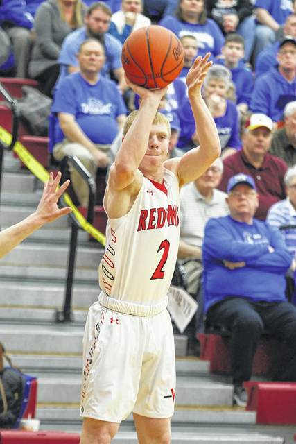 Gage Schenk puts up a shot against Defiance during a Friday night Division II sectional final at Lima Senior.