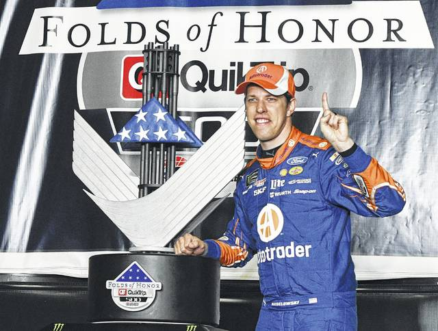 Brad Keselowski poses with the trophy in victory lane after winning a NASCAR Monster Cup series auto race at Atlanta Motor Speedway in Hampton, Ga., on Sunday.