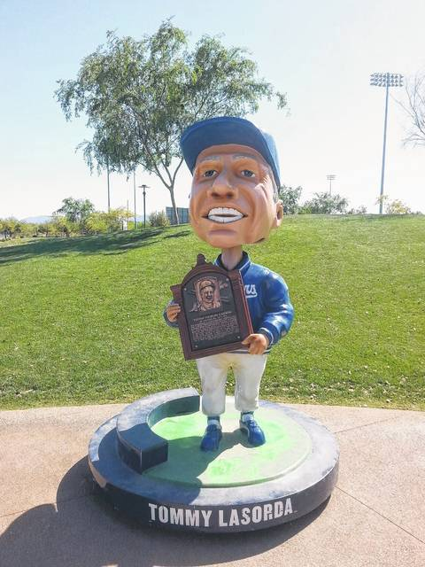 This giant bobble head of Tommy Lasorda stands outside the Los Angeles Dodgers spring training park in Glendale, Ariz. The real Lasorda signs autographs nearby every day in the spring.