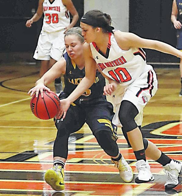 ONU Britt Lauck (10) looks to make a steal against Lakeland's Kayla Clark (5) at Ohio Northern University Saturday. the Ohio Athletic Conference Player of the Year was a major factor in the Polar Bears going undefeated and reaching the Sweet 16.