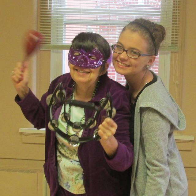 Matt Thuman, Wapakoneta   Submitted photo Resident Jenny Anderson dances with Activities Assistant Kiyla Collins at Auglaize Acres Mardi Gras celebration. Share your photos at http://j.mp/limaphotos.