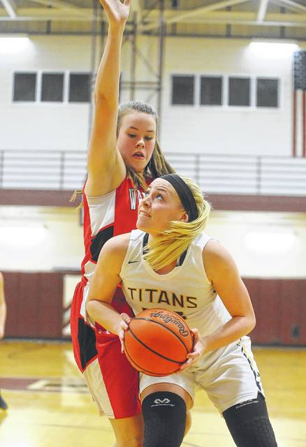 Ottawa-Glandorf's Kylie White goes up for a shot against Wapakoneta's Sarah Pothast during Saturday's Division II district final at Paulding High School.