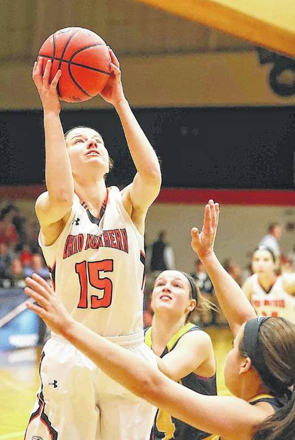 Ohio Northern's Abby Weeks pulls down a rebound against Lakeland's Amanda Majewski (4) and Bailey Grayvold, right, during a Division III first round tournament game Friday night at the ONU Sports Center.