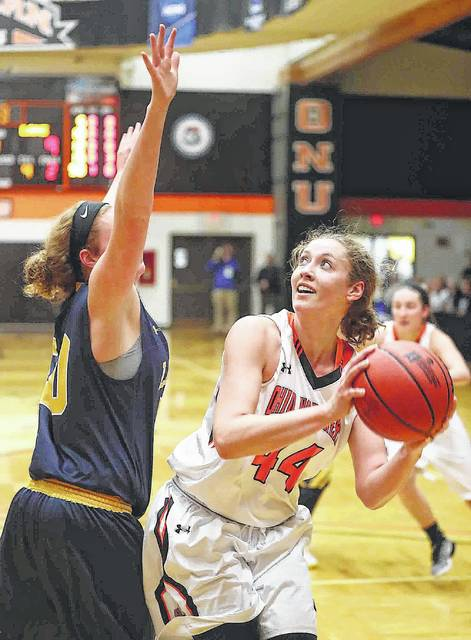 Ohio Northern's Amy Bullimore eyes the basket while being defended by Lakeland's Maddy Doll during a Division III first round tournament game Friday night at the ONU Sports Center.