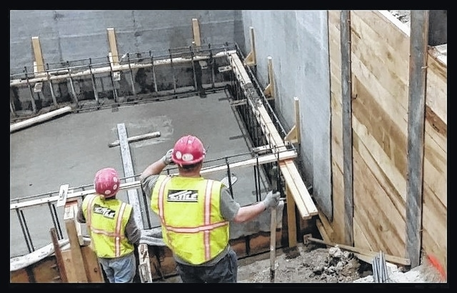 Workers from Tuttle Construction, Inc., work on a project recently.