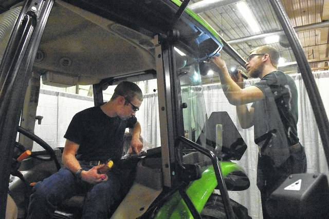Joshua Hoenie, 16, left, and Ken Bertke, 17, students from Coldwater High School trouble-shoot for an electrical problem on a John Deere 5075E tractor during the University of Northwestern Ohio State of Ohio Agricultural Power Diagnostics CDE contest on Friday. The top 15 high schools teams from the State of Ohio were on campus competing for more than $75,000 in scholarships.