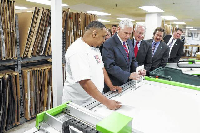 "Vice President Mike Pence, center right, and Health and Human Services Secretary Tom Price, third from right, are given a tour of the Frame USA facility, Thursday, March 2, 2017, in Springdale, Ohio. Pence visited Ohio to discuss healthcare and other issues while engaging in a ""listening session"" with small business owners."