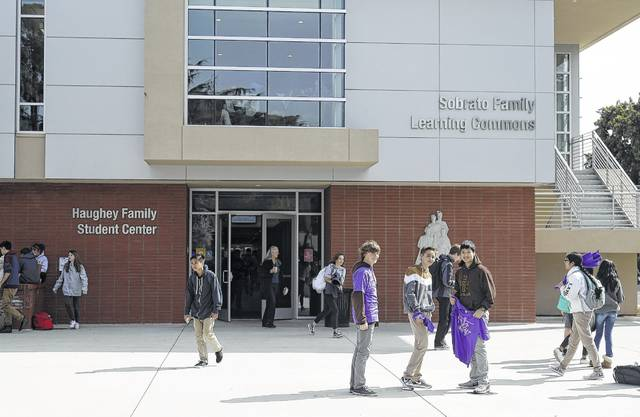 Students are seen at St. Francis High School Friday, March 3, 2017, in Mountain View, Calif. The red-hot IPO debut of vanishing-photo superstar Snap this week not only placed the Southern California startup at a $35 billion value. It also made Mountain View, Calif.'s Saint Francis high school $23 million richer. The Catholic school had invested $15,000 in Snap's early round of funding way back in 2012. By the time shares in Snap had finished trading Thursday afternoon, that pittance had turned into a big fat pile of shareholder value.
