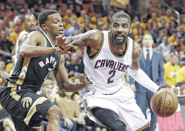 82ee252d7fe6 Cleveland Cavaliers guard Kyrie Irving (2) drives past the Toronto Raptors   Kyle Lowry
