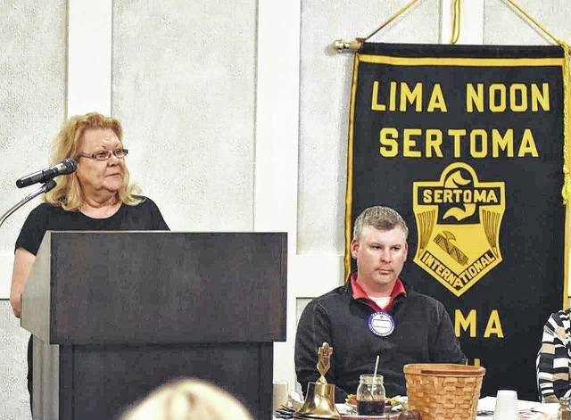 Lori Hubbard, foster care caseworker with Allen County Children Services,  addresses the Lima Noon Sertoma Club on Tuesday afternoon.