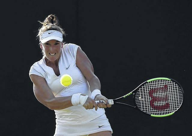 Madison Brengle hits a return during her Wednesday match against Petra Kvitova at the Wimbledon Tennis Championships in London.