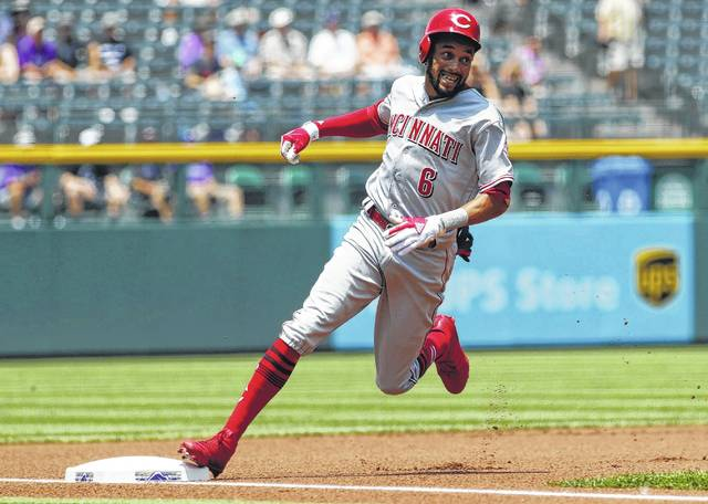 Cincinnati's Billy Hamilton reaches third base with a stand-up triple during Thursday's game against Colorado in Denver.