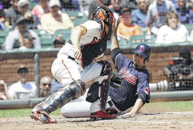 Cleveland's Carlos Carrasco scores against  the Giants' Nick Hundley during Wednesday's game in San Francisco.