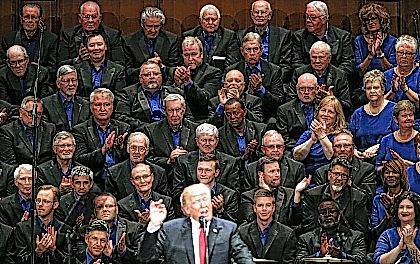 Members of the First Baptist Dallas Church Choir are seated behind President Donald Trump as he speaks during the Celebrate Freedom event at the Kennedy Center for the Performing Arts in Washington, Saturday, July 1, 2017. (AP Photo/Carolyn Kaster)