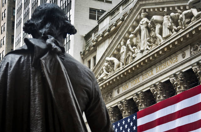 FILE - In this Wednesday, July 8, 2015, file photo, a statue of George Washington stands at Federal Hall near the flag-covered pillars of the New York Stock Exchange, in New York. Global shares are mostly higher in Europe, Wednesday, July 5, 2017, after Asia reversed early losses spurred by concern over North Korea's launch of a long-range missile on Tuesday. Trading was subdued after the U.S. Independence Day holiday and ahead of the summit of the Group of 20 industrial nations later in the week. (AP Photo/Bebeto Matthews, File)