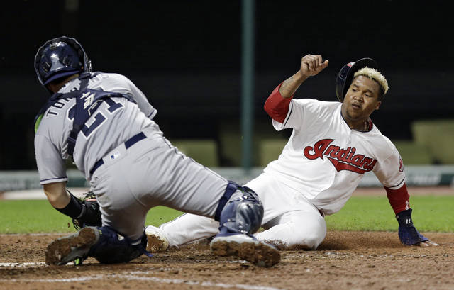 Cleveland Indians' Jose Ramirez, right, is tagged out at home plate by San Diego Padres catcher Luis Torrens during the eighth inning of a baseball game, Wednesday, July 5, 2017, in Cleveland. (AP Photo/Tony Dejak)