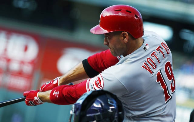 Cincinnati Reds' Joey Votto flies out on a pitch from Colorado Rockies starting pitcher Jon Gray to end the top of the first inning of a baseball game Wednesday, July 5, 2017, in Denver. (AP Photo/David Zalubowski)
