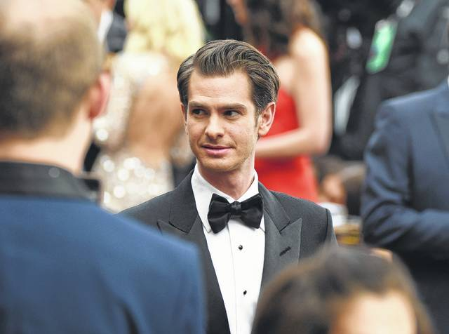 """On Feb. 26, Andrew Garfield arrives at the Oscars at the Dolby Theatre in Los Angeles. Garfield is getting criticized after Britain's Gay Times reported that he told an audience he was gay, but """"without the physical act."""""""