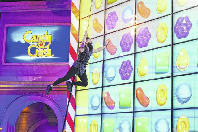 """This image released by CBS shows Paul Abrahamian, a former contestant on """"Big Brother 18"""" and """"Survivor,"""" competing in the new game show, """"Candy Crush,"""" premiering Sunday on CBS."""