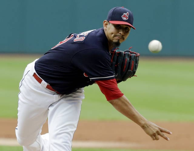 Cleveland Indians starting pitcher Carlos Carrasco delivers in the first inning of the team's baseball game against the Detroit Tigers, Friday, July 7, 2017, in Cleveland. (AP Photo/Tony Dejak)