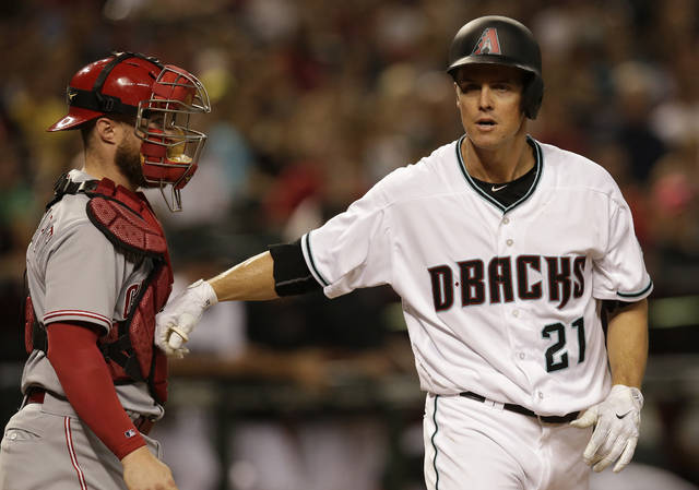 Arizona Diamondbacks Zack Greinke (21) reacts with Cincinnati Reds catcher Tucker Barnhart after getting hit by a pitch in the second inning during a baseball game, Friday, July 7, 2017, in Phoenix. (AP Photo/Rick Scuteri)
