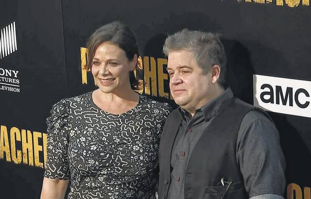 "In this June 20 file image taken from video, Meredith Salenger, left, and Patton Oswalt arrive at the premiere of AMC's ""The Preacher"" in Los Angeles. Oswalt is defending his engagement to Salenger from online critics who say the comedian is getting married too soon after his wife's death last year."