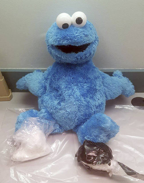 This undated photo provided by the Monroe County Sheriff's Office, shows the Cookie Monster doll discovered by a deputy with two packages of cocaine hidden inside. The Monroe County Sheriff's Office said in a news release Wednesday, July 12, 2017, that 39-year-old Camus McNair was arrested after a Florida Keys traffic stop involving a car with heavily tinted windows and an obscured license plate. (Deputy Matthew Cory/Monroe County Sheriff's Office via AP)