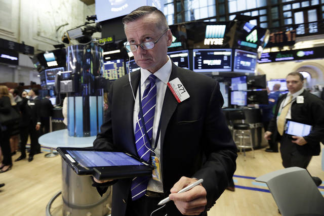 Trader Neil Catania works on the floor of the New York Stock Exchange, Wednesday, July 12, 2017. Stocks are opening solidly higher on Wall Street, led by gains in technology companies. (AP Photo/Richard Drew)
