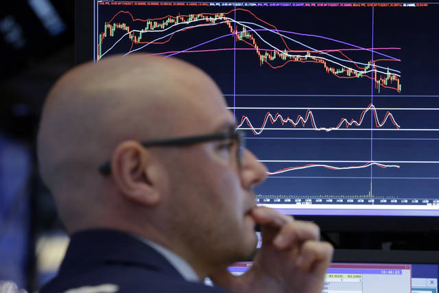 Specialist Mario Picone works at his post on the floor of the New York Stock Exchange, Tuesday, July 18, 2017. U.S. stocks and the dollar are slipping Tuesday morning after the latest Republican health care bill failed in the Senate. (AP Photo/Richard Drew)