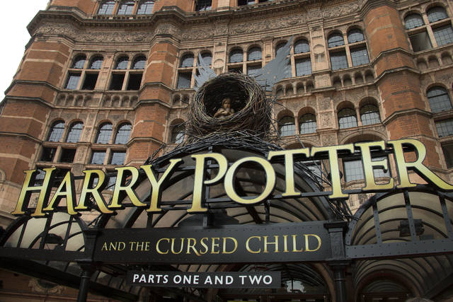 """This July 30, 2016, file photo shows the Palace Theatre in central London which is showing a stage production of, """"Harry Potter and the Cursed Child."""" Harry Potter publisher Bloomsbury announced that two new books from the Harry Potter universe are set to be released in October as part of a British exhibition that celebrates the 20th anniversary of the launch of the series."""