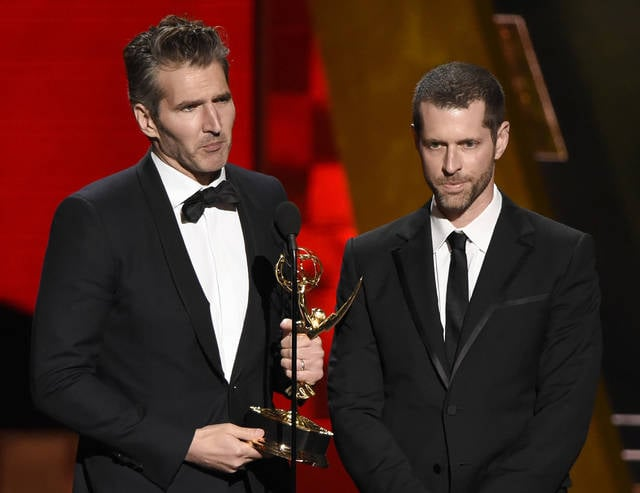 """Creator-showrunners David Benioff, left, and D.B. Weiss accept the award for outstanding writing for a drama series for """"Game Of Thrones"""" at the 67th Primetime Emmy Awards in Los Angeles in September 2015. HBO's announcement Wednesday that Benioff and Weiss will follow """"Game of Thrones"""" with an HBO series in which slavery remains legal in the modern-day South drew fire on social media from those who fear that a pair of white producers are unfit to tell that story and that telling it will glorify racism."""