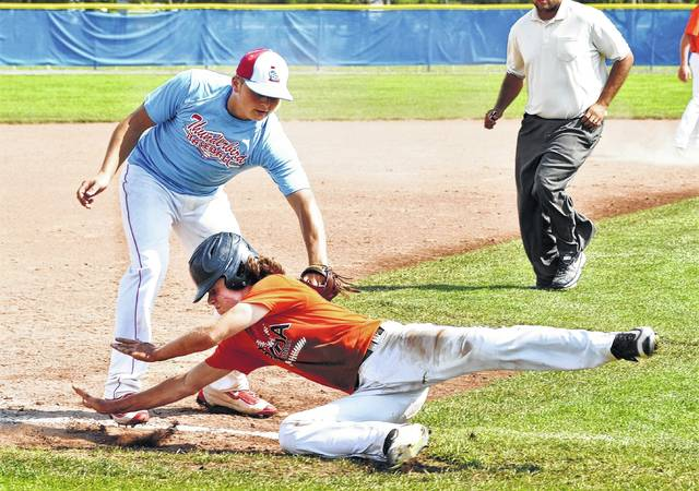Lima Central Catholic's Jay Riepenhoff tags Elida's Jordan Davis out on a rundown in the District 5 ACME tournament Monday.