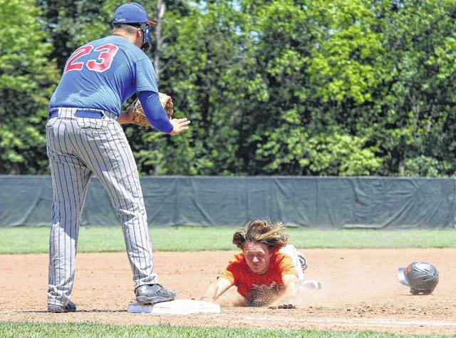 Elida's Jordan Davis slides into third base and loses his helmet as third baseman Crestview's Dylan Hicks watces Sunday afternoon in the ACME district tournament at Elida.
