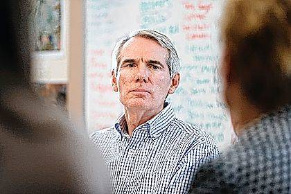 Sen. Rob Portman, R-Ohio, listens during a roundtable discussion with former addiction recovery clients and current employees at the Adams Recovery Center for Women on Wednesday in Cincinnati. Portman discussed the importance of increased funding for addiction treatment and efforts to combat the ovoid epidemic in Ohio.