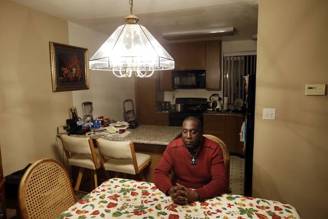 ADVANCE FOR RELEASE SUNDAY, JULY 9, 2017, AT 12:01 A.M. EDT. AND THEREAFTER- FILE - In this Nov. 9, 2015, file photo, Pastor Yul Dorn poses for a portrait inside his home, where he was facing eviction due to foreclosure in San Francisco's Bayview-Hunters Point district. Dorn and his wife expect to join the growing ranks of African-Americans who do not own their homes, a rate that was nearly 30 percentage points higher than that of whites in 2016, according to a report by Harvard University's Joint Center for Housing Studies. The nation's homeownership rate appears to be stabilizing as people rebound from the 2007 recession according to the report. But it found African Americans aren't sharing in the recovery, even as whites, Asian Americans and Latinos slowly see gains in home-buying. The center said the disparity between whites and blacks is at its highest in 70-plus years of data. (AP Photo/Marcio Jose Sanchez, File)
