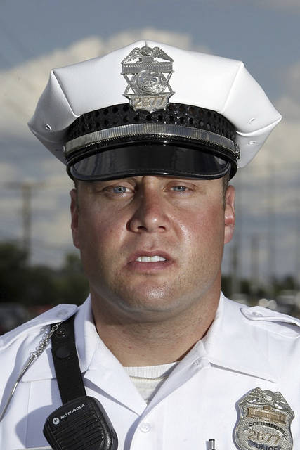FILE – This undated file photo shows Columbus, Ohio, police officer Zachary Rosen in Columbus, Ohio. Columbus Public Safety Director Ned Pettus Jr. announced Monday, July 10, 2017, that Rosen has been fired, after a video recorded April 8, 2017, showed Rosen subduing a restrained suspect in a way that appeared to show him kicking the prone man in the head. (Jonathan Quilter/The Columbus Dispatch via AP, File)