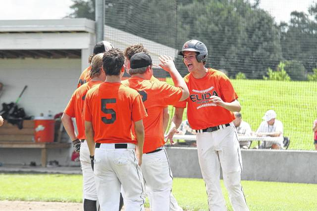 Elida players celebrate their District 5 ACME Tournament first-round win Saturday against Van Wert at Elida's Dick Prince Field. See more ACME photos at LimaScores.com