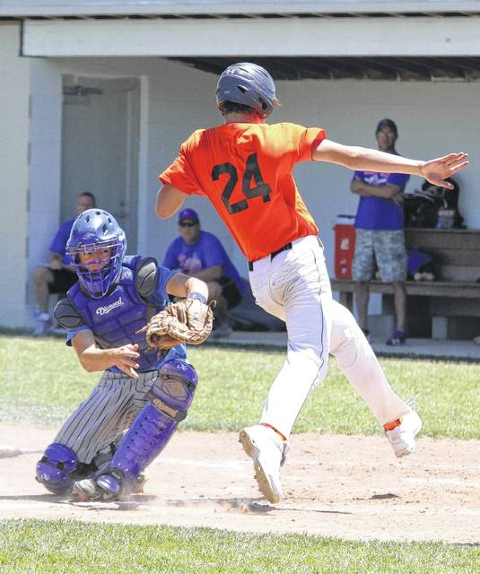 Elida's Max Parker squeezes right past the Crestview catcher to score a runin the ACME district tournament game Sunday.