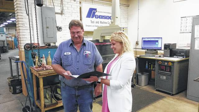Rebecca Hunt, right, a representative from Ohio Secretary of State Jon Husted's office, presented Gasdorf Tool & Machine Co. owner Mark Krohn with a certificate of appreciation for being included in the Secretary of State's July Ohio Business Profile.