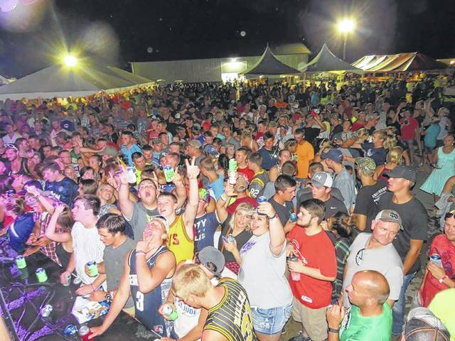 Crowds enjoy listening to the live music at last year's Huggy Bear Campground Showcase of Bands for St. Jude Children's Research Hospital.