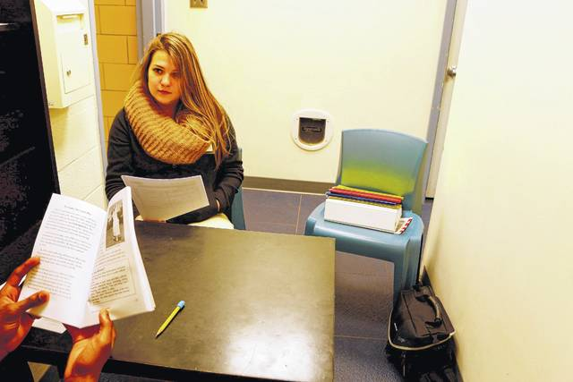 Claire DeOrio, a Bluffton University educational major, teaches a youth incarcerated at the Allen County Juvenile Dentention Center. DeOrio was one of the first Bluffton students to take on the task of mentoring ACJDC students one-one-one.