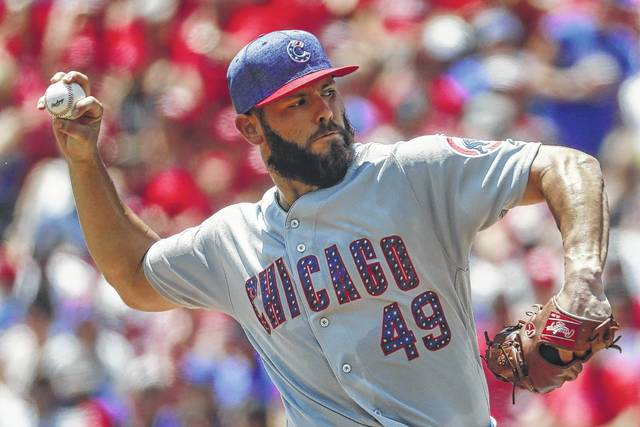 Chicago Cubs starting pitcher Jake Arrieta throws in the first inning of a baseball game against the Cincinnati Reds on Sunday. The Cubs won 6-2.