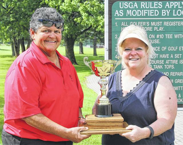 Charlotte Schaub, left, and Karen Fisher display the Katte's Ladies Cup trophy that two teams are competing for in a three-day tournament this weekend.