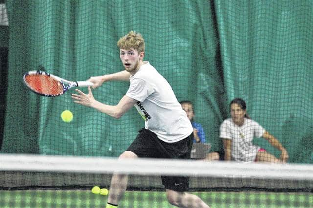 Shawnee's Jake Liddle prepares to return a shot during first round play of the Lima Area Tennis Association men's singles tournament Friday at Westwood Tennis and Fitness Center. Action was moved indoors due to the rain.