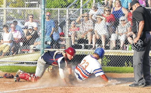 Garrett Hodges (23) of the Lima Locos is safe at home as Licking County's Jarrett Peters misses the tag during an 11-6 win by the Locos on Tuesday at Simmons Field.