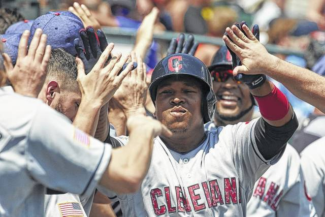 Jose Ramirez of the Cleveland Indians is congratulated by teammates after hitting a three-run home run against the Detroit Tigers on Sunday in Detroit.