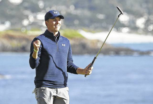 Jordan Spieth reacts on the 18th green of the Pebble Beach Golf Links after winning the AT&T Pebble Beach National Pro-Am golf tournament in January in Pebble Beach, Calif. Spieth.