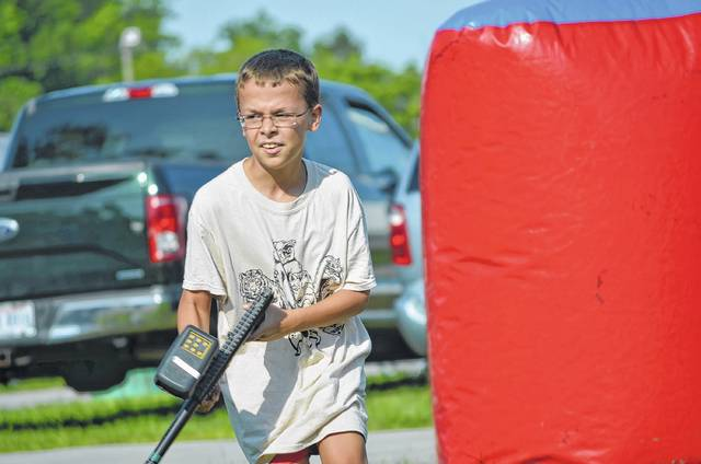 Trevor Steinke, 10, of Wapakoneta, plays laser tag Tuesday during the St. Joseph Festival at the Auglaize County Fairgrounds in Wapakoneta.