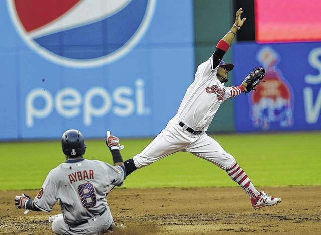Cleveland Indians' Francisco Lindor reaches for a ball before tagging out San Diego Padres' Erick Aybar at second base in the fifth inning of a baseball game, Tuesday, July 4, 2017, in Cleveland. (AP Photo/Tony Dejak)